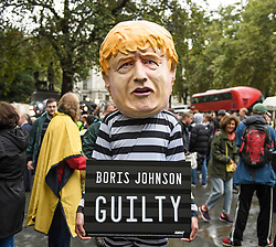 © Licensed to London News Pictures. 24/09/2019. London, UK. A man dressed as British Prime Minister Boris Johnson in a prison outfit, outside  The Supreme Court in London following a ruling on an appeal against a judicial review of Boris Johnson's suspension of Parliament. The case has been brought by remain campaigner Gina Miller, with support from former British Prime Minister John Major. Photo credit: Ben Cawthra/LNP