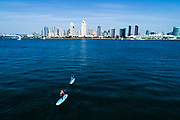 Jessica Rocheleau and Andrew Mencinsky paddling in San Diego Bay for Boardworks.