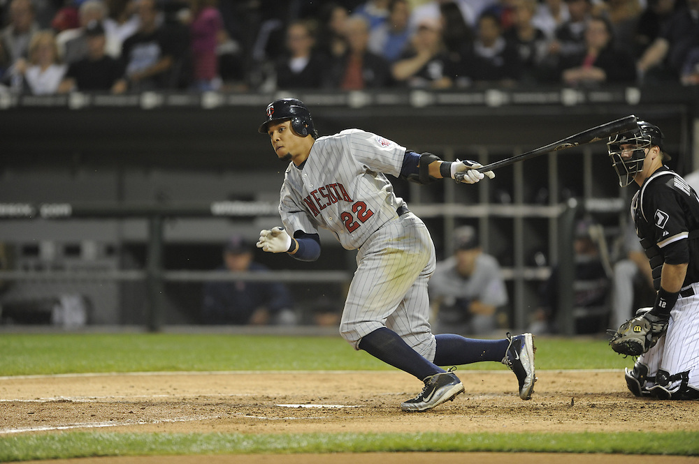 CHICAGO - SEPTEMBER 23:  Carlos Gomez #22 of the Minnesota Twins hits a RBI double in the fourth inning against the Chicago White Sox on September 23, 2009 at U.S. Cellular Field in Chicago, Illinois.  The Twins defeated the White Sox 8-6.  (Photo by Ron Vesely)