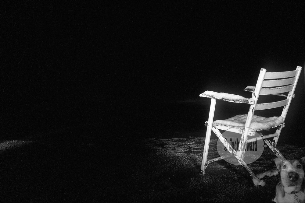 02/2004 - Avon Beach, NJ - An antique fishing chair, dusted with snow, sits on the beach.<br /> <br /> Jack Howard Photograph