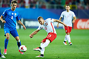 Lublin, Poland - 2017 June 16: Lukasz Moneta from Poland U21 shoots on the goal while Poland v Slovakia match during 2017 UEFA European Under-21 Championship at Lublin Arena on June 16, 2017 in Lublin, Poland.<br /> <br /> Mandatory credit:<br /> Photo by &copy; Adam Nurkiewicz / Mediasport<br /> <br /> Adam Nurkiewicz declares that he has no rights to the image of people at the photographs of his authorship.<br /> <br /> Picture also available in RAW (NEF) or TIFF format on special request.<br /> <br /> Any editorial, commercial or promotional use requires written permission from the author of image.