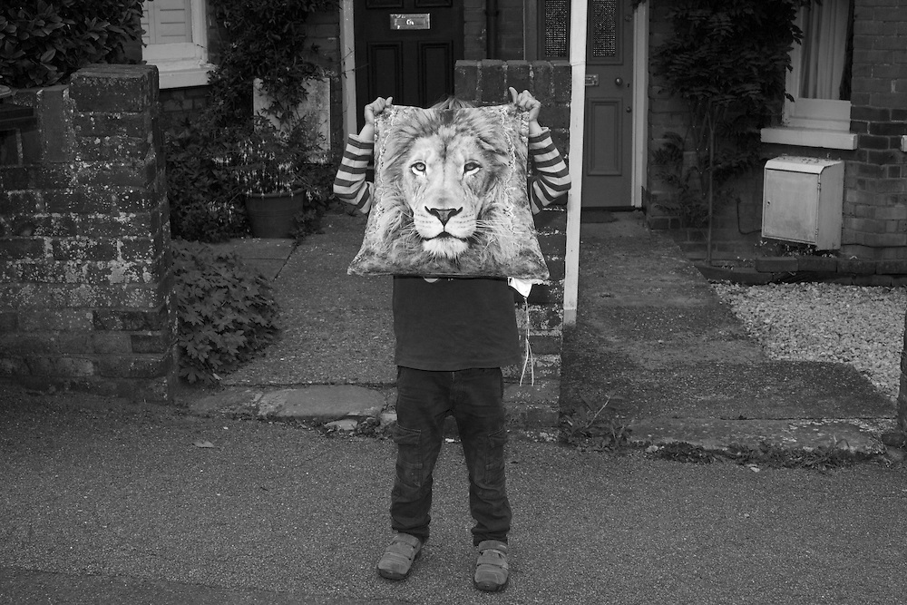 Ben puts a pillow across his face pretending to be a Lion outside home in Berkhamsted, England  Tuesday, Aug. 18, 2015 (Elizabeth Dalziel) #thesecretlifeofmothers #bringinguptheboys #dailylife