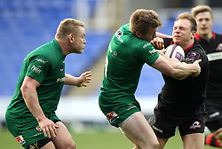 Edinburgh's Greig Tonks is tackled by London Irish's Halani Aulika - Photo mandatory by-line: Robbie Stephenson/JMP - Mobile: 07966 386802 - 05/04/2015 - SPORT - Rugby - Reading - Madejski Stadium - London Irish v Edinburgh Rugby - European Rugby Challenge Cup