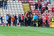 Ben Richard-Everton of Bradford City jumps on the celebrations as fans rush onto the pitch during the EFL Sky Bet League 2 match between Bradford City and Northampton Town at the Utilita Energy Stadium, Bradford, England on 7 September 2019.