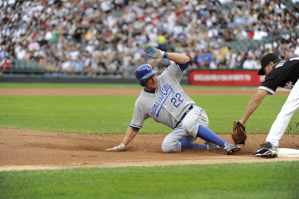 CHICAGO - JULY 10:  Scott Podsednik #22 of the Kansas City Royals is tagged out attempting to steal third base by Omar Vizquel #11 of the Chicago White Sox in the first inning on July 10, 2010 at U.S. Cellular Field in Chicago, Illinois.  The White Sox defeated the Royals 5-1.  (Photo by Ron Vesely)