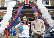 UNITED KINGDOM, London: 08 May 2020 <br /> Jane Lyde and her husband Toby, who run a balloon business, join in the VE Day celebrations outside of their house this morning. The couple have decorated their house with balloons and ribbons in celebration of the 75th anniversary of Victory in Europe Day (VE Day).