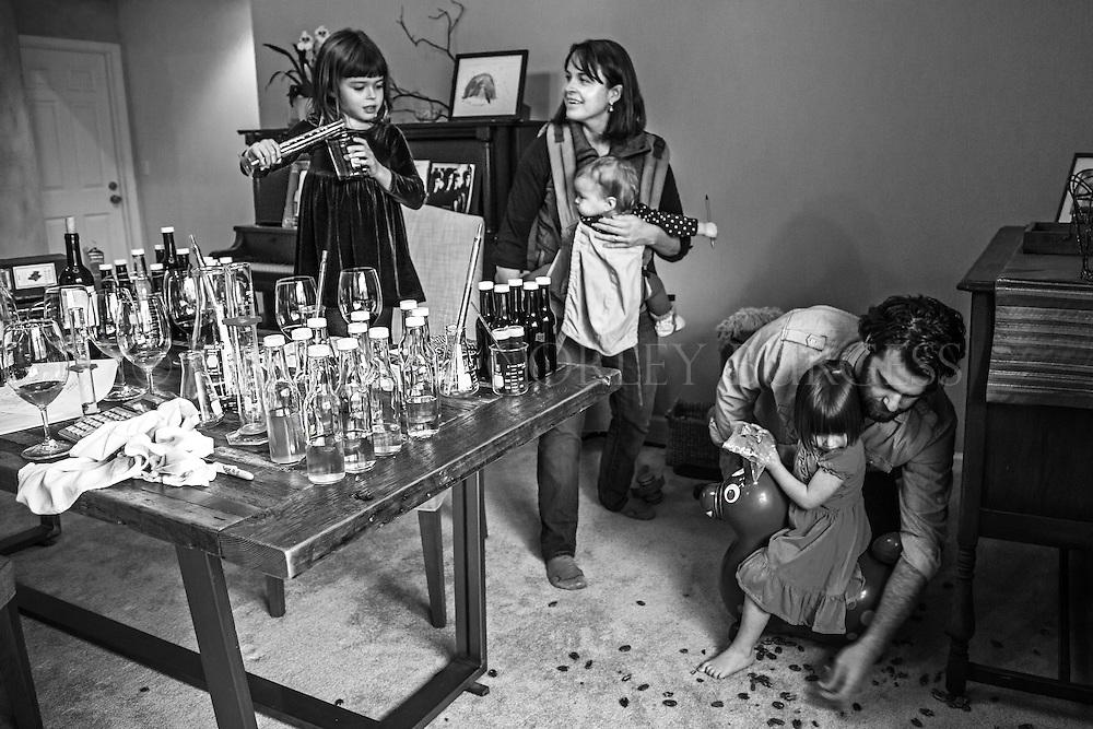 creative portrait showing the life of working winemaker parents, Jen and Mark of Zeitgeist Cellars.