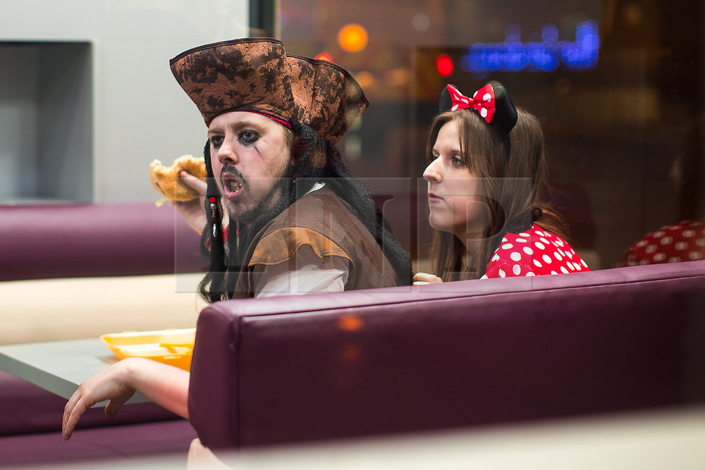 © Licensed to London News Pictures . 08/04/2017 . Manchester , UK . People eating fast food on Dantzic Street as a Disney themed pub crawl passes through The Printworks in Manchester City Centre . Greater Manchester Police have authorised dispersal powers and say they will ban people from the city centre for 48 hours , this evening (7th April 2017) , in order to tackle alcohol and spice abuse . Photo credit : Joel Goodman/LNP