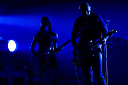 © Licensed to London News Pictures. 22/07/2013. London, UK.   The Smashing Pumpkins performing live at Wembley Arena.  In this pic - Nicole Fiorentino (left) and Billy Corgan (right).  The Smashing Pumpkins is an American alternative rock band from Chicago, consisting of Billy Corgan (lead vocals, lead guitar) Mike Byrne (drums), Nicole Fiorentino (bass guitar, backing vocals), and Jeff Schroeder (rhythm guitar).  Photo credit : Richard Isaac/LNP