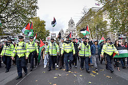 "© Licensed to London News Pictures. 04/11/2017. London, UK.  Police control demonstrators taking part in ""Justice Now: Make It Right For Palestine"", a march from Grosvenor Square to a rally in Parliament Square, demanding justice and equal rights for Palestinians on the centenary of the Balfour Declaration.  Photo credit: Stephen Chung/LNP"