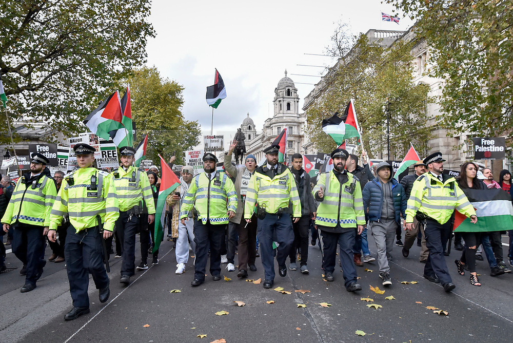 """© Licensed to London News Pictures. 04/11/2017. London, UK.  Police control demonstrators taking part in """"Justice Now: Make It Right For Palestine"""", a march from Grosvenor Square to a rally in Parliament Square, demanding justice and equal rights for Palestinians on the centenary of the Balfour Declaration.  Photo credit: Stephen Chung/LNP"""