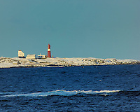 Lighthouse while Traveling to Alesund. Image taken with a Nikon D2xs and 80-400 mm VR lens (ISO 200, 400 mm, f/9.5, 1/350 sec).