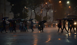 July 19, 2017 - Kolkata, West Bengal, India - Indian commuters crossing the road during the rain in Kolkata, India on Wednesday , 19th July 2017. (Credit Image: © Sonali Pal Chaudhury/NurPhoto via ZUMA Press)