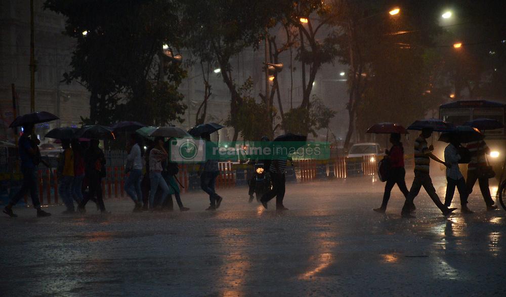 July 19, 2017 - Kolkata, West Bengal, India - Indian commuters crossing the road during the rain in Kolkata, India on Wednesday , 19th July 2017. (Credit Image: © Sonali Pal Chaudhury/NurPhoto via ZUMA Press)