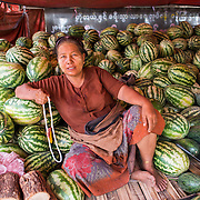 A woman sells watermelons at a stall in the morning market at Myinkaba Village, a small local village that lies between Old Bagan and New Bagan in Myanmar.