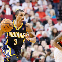 02 December 2013: Indiana Pacers point guard George Hill (3) brings the ball upcourt on the fast break  during the Portland Trail Blazers 106-102 victory over the Indiana Pacers at the Moda Center, Portland, Oregon, USA.