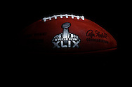 An official game ball for the NFL football Super Bowl XLIX is photographed, Tuesday, Jan. 20, 2015, at the Wilson Sporting Goods football factory in Ada, Ohio. The company, which has made the official Super Bowl football since the first Super Bowl in 1966, began making the this year's game balls last Sunday night, Jan. 18, immediately after the conclusion of the NFC and AFC championship games. The New England Patriots take on the Seattle Seahawks in the NFL championship on Sunday, Feb. 1, in Glendale, Ariz. (AP Photo/Rick Osentoski)