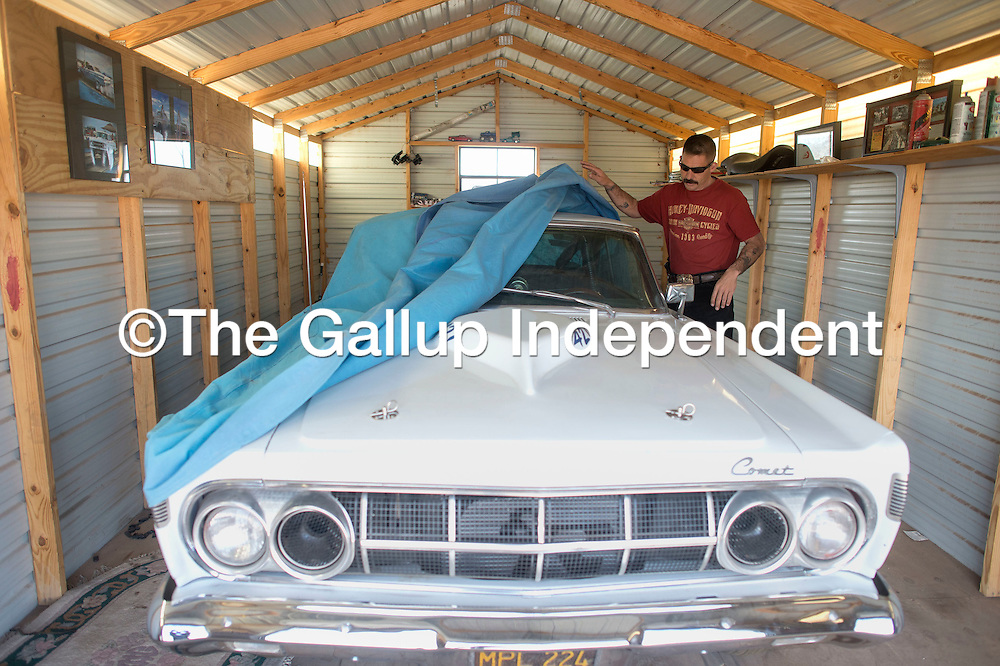 Sheriff Tony Mace unveils his '64 Comet Cyclone at a shed on his property in Grants March 7. Sheriff Mace intends to get the car ready for an upcoming race in Nevada.