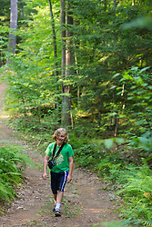 A boy walking a forest trail in Madbury, New Hampshire.