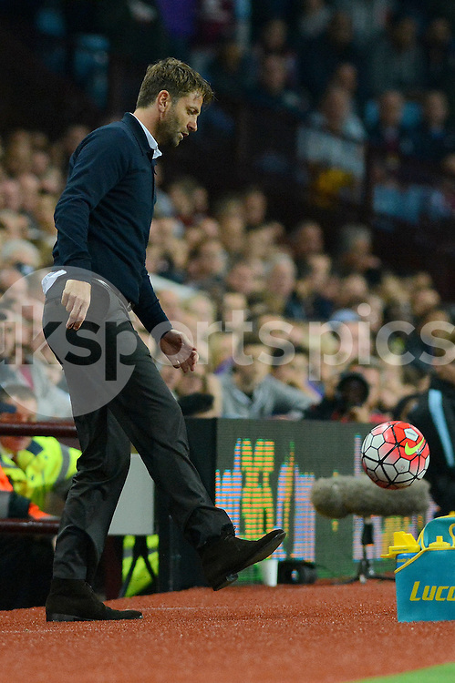 Aston Villa manager Tim Sherwood flicks the ball back into play during the Barclays Premier League match between Aston Villa and Manchester United at Villa Park, Birmingham, England on 14 August 2015. Photo by Garry Griffiths.