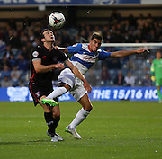 Luke Joyce battling for ball with Reece Grego-Cox in a toughly fought 20 mintues during the Capital One Cup match between Queens Park Rangers and Carlisle United at the Loftus Road Stadium, London, England on 25 August 2015. Photo by Matthew Redman.