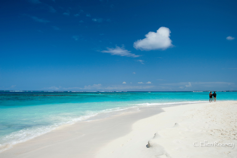 A couple walking along the beach at  Shoal Bay East, Anguilla, British West Indies,<br /> The Caribbean