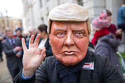© Licensed to London News Pictures. 06/02/2018. London, UK. Demonstrators take part in a protest  organised by 'War on Want', calling on MPs to demand parliamentary scrutiny of trade deals. The protestors are wearing costumes depicting Donald Trump, Theresa May, Liam Fox, bankers and judges. They are Photo credit : Tom Nicholson/LNP