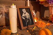 New York, NY, October 31, 2013. Candles and a photograph on the public altar in memory of the deceased.