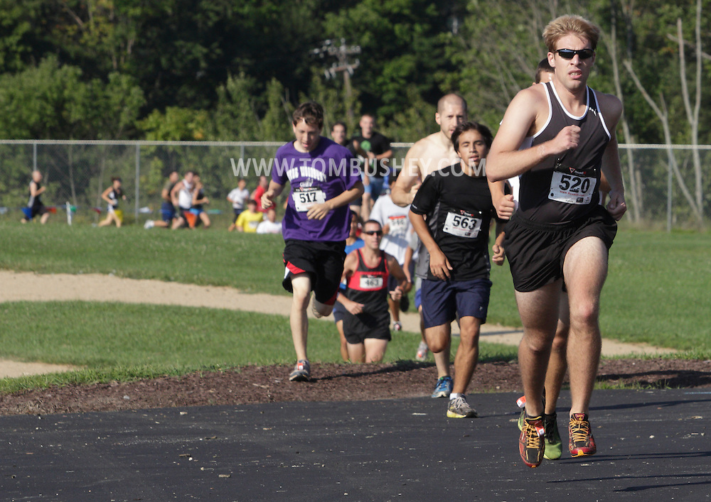 Central Valley, New York - Eventual winnter Tom Zarnoch takes an early lead in the Woodbury Country Ramble race on Aug. 26, 2012.