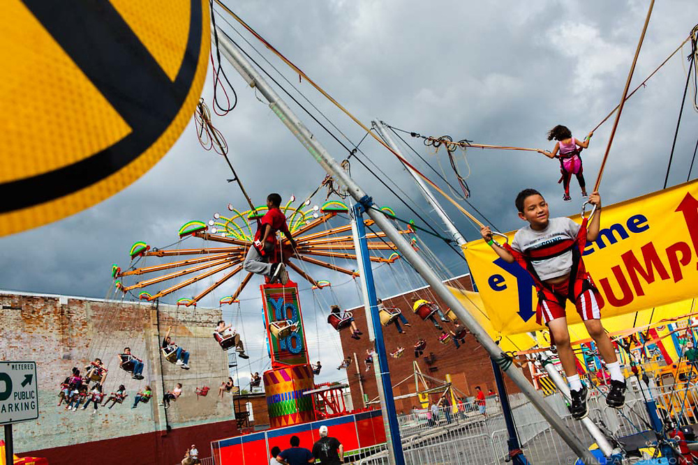 David Backus (right), 7, Cavonte Lomax, 9, and Erica Cochran, 8, all of Marion, Ohio, bounce on trampolines during the Marion Popcorn Festival on September 9, 2011. Tens of thousands of visitors enjoyed carnival rides, crafts, food vendors, live music and a parade during the annual three-day festival.
