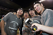 """HOUSTON - OCTOBER 26:  Rock singer Steve Perry, formally of the band Jourrny, sings """"Don't Stop Believin'"""" with A.J. Pierzynski, Aaron Rowand and Joe Crede after Game 4 of the 2005 World Series against the Houston Astros at Minute Maid Park on October 26, 2005 in Chicago, Illinois.  The White Sox defeated the Astros 1-0 to win the 2005 World Series.  (Photo by Ron Vesely)"""