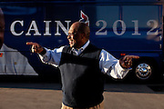 Republican presidential candidate Herman Cain asks for directions as he arrives at the Dickinson County GOP Summer Picnic in Okoboji, Iowa, August 10, 2011.