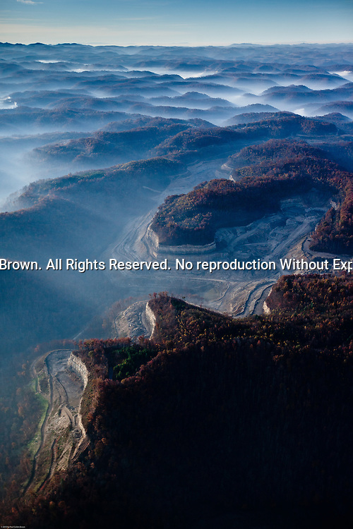 Smoke from burning trees fills the valleys of the Coal River area in Boone County, WV.