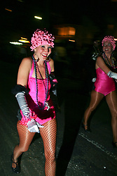 Feb 23rd, 2006. New Orleans, Louisiana. The Krewe of Muses. Muses is the only all women's Krewe to parade in New Orleans and is known for its satire, famous shoe throws and is generally considered one of the most popular parades of the Mardi Gras. Dancing girls parade the route with Muses.