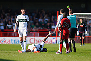Plymouth Argyle defender Yann Songo'o (4) calls for help after a tackle from Crawley Town forward James Collins (19), for which he received his second yellow and was sent off, during the EFL Sky Bet League 2 match between Crawley Town and Plymouth Argyle at the Checkatrade.com Stadium, Crawley, England on 8 April 2017. Photo by David Charbit.