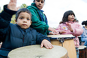 Hanan Otero, (3) Emily Reyes ( 7) and Hannah Otero (5) (L-R) all of Lorain bang away on the drums during a drumming circle at the Lorain County Community College Family Fest on Saturday, Oct. 18.