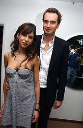 FRITZ VON WESTENHOLZ and CAROLINE SIEBER at a party to celebrate the publication of Tatler's Little Black Book 2006 held at 24, 24 Kingley Street, London W1 on 9th November 2006.<br />