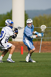 North Carolina midfielder Bobby Mcauley (43) is defended by Duke attackman Zach Howell (26).  The #2 ranked Duke Blue Devils defeated the #12 ranked North Carolina Tar Heels 17-6 in the semi finals of the Men's 2008 Atlantic Coast Conference tournament at the University of Virginia's Klockner Stadium in Charlottesville, VA on April 25, 2008.