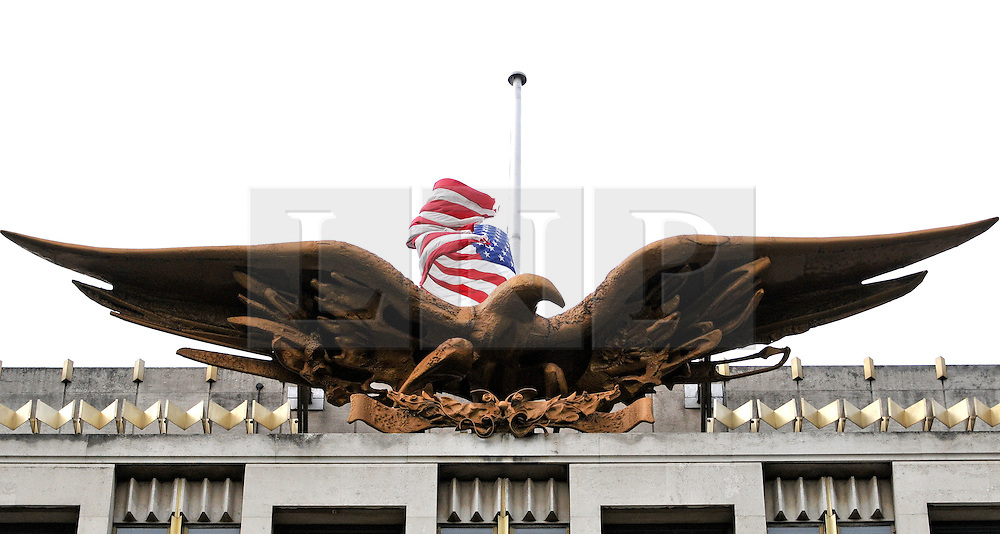 CENTRAL LONDON. The American flag at half mast on the American Embassy in London.  Family and friends of those killed in the World Trade Centre attacks in New York in 2001 visit the memorial to the British victims in Grosvenor Square.  11 September 2010. STEPHEN SIMPSON.