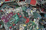 A stack of motherboards wait to be processed in the junk yards of Nanyang.