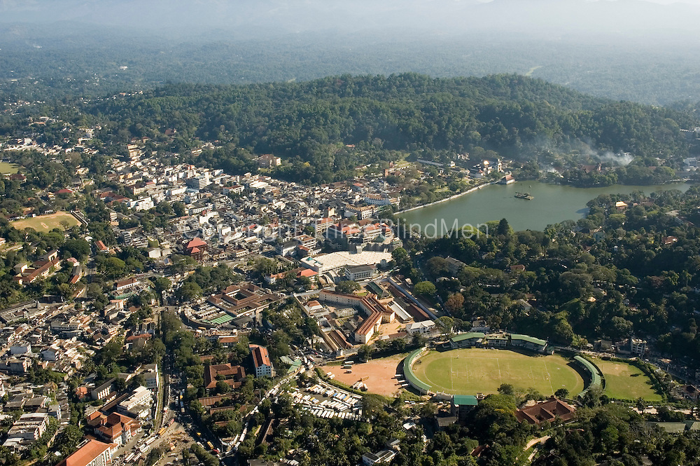 Kandy, the second largest city in Sri Lanka. Bogambara cricket ground at bottom right.(next to the Bogambara prison). Kandy Lake in the distance.