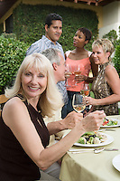 Woman drinking wine with friends outdoors