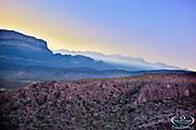 Sunrise streaming over Sierra del Carmen on the eastern border of Big Bend National Park