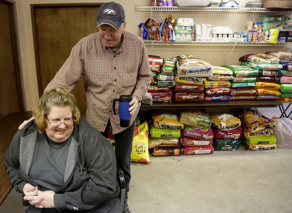 Diana Gent and husband Tom Gent helped organize animal food supplies for those in need at the rodeo grounds in Darrington, Washington March 27, 2014. A rainy forecast for Thursday dimmed prospects on the sixth day of searching after a rain-soaked mountainside gave way on Saturday morning near Oso, Washington. The slide cascaded over a river and a road into homes, blanketing about a square mile in muck and debris.  REUTERS/Jason Redmond (UNITED STATES)