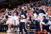 CHARLOTTESVILLE, VA - DECEMBER 4: Virginia Cavaliers players on the bench celebrate against the Wisconsin Badgers during the Big Ten/ACC Challenge game at John Paul Jones Arena on December 4, 2013 in Charlottesville, Virginia. Wisconsin won 48-38. (Photo by Joe Robbins) *** Local Caption ***