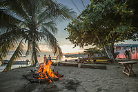 Tourists and locals enjoy evening in a variety of ways, on west coast of Little Corn Island, Nicaragua. Copyright 2017 Reid McNally.