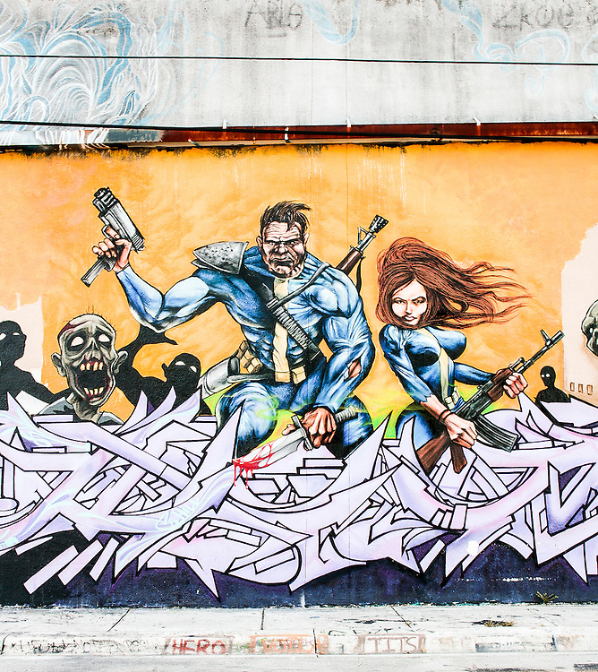 Weapons-toting, comic book-style superheros on a mural on a wall in Wynwood