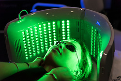 © Licensed to London News Pictures. 25/02/2019. LONDON, UK. A woman enjoys an LED light treatment at Professional Beauty, the UK's largest beauty and spa trade show, taking place at Excel London in Docklands.  Photo credit: Stephen Chung/LNP