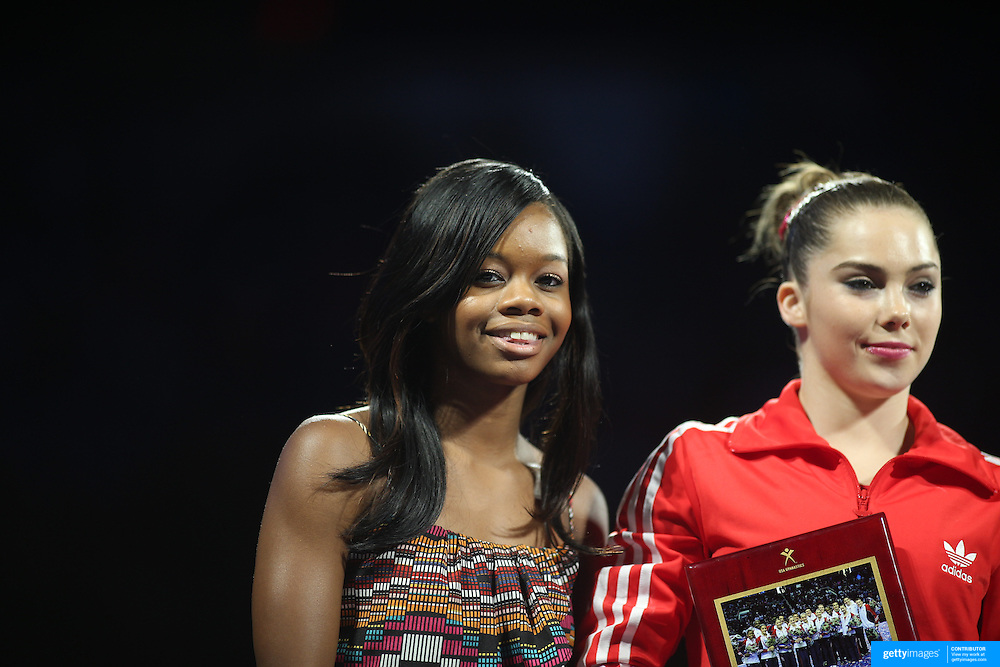 Gabby Douglas, (left), and McKayla Maroney, during presentation at the Senior Women Competition at The 2013 P&G Gymnastics Championships, USA Gymnastics' National Championships at the XL, Centre, Hartford, Connecticut, USA. 17th August 2013. Photo Tim Clayton