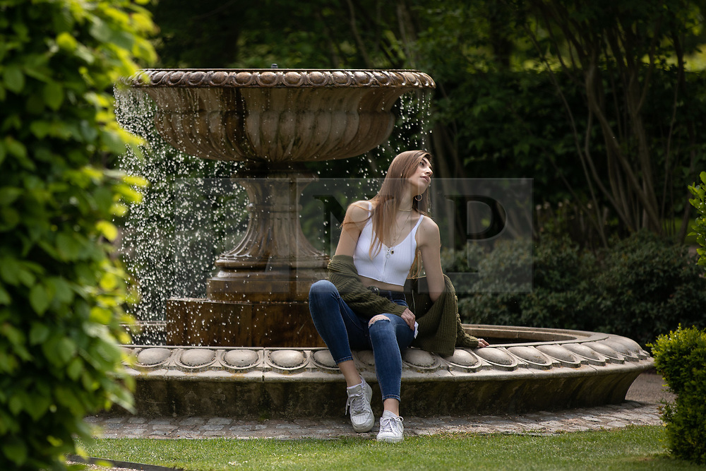 © Licensed to London News Pictures. 30/04/2019. London, UK. A woman poses for a photo in the sun in Regent's Park on a warm afternoon in central London. Photo credit : Tom Nicholson/LNP